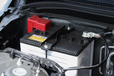 Battery in engine section of a