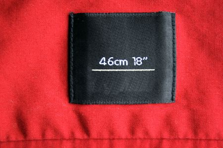 real macro of clothing label size 46 sm ore 18