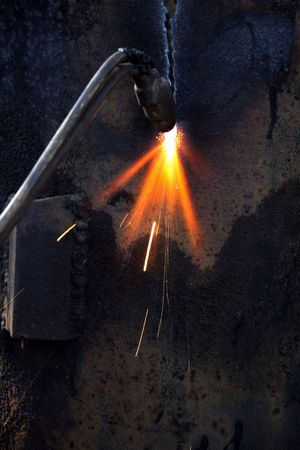 Cutting torch of gas welding during metal cutting photo