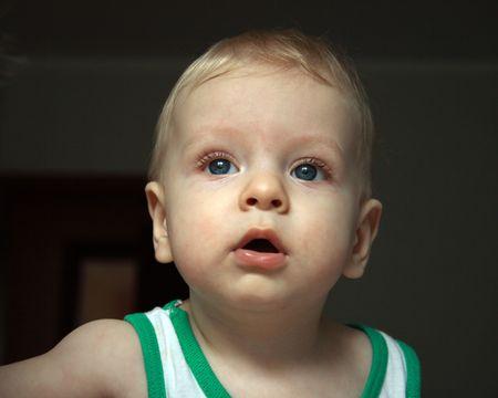 Close up baby boy portrat on dark background photo