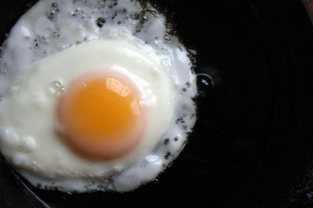 scrambled egg on a black frying pan photo