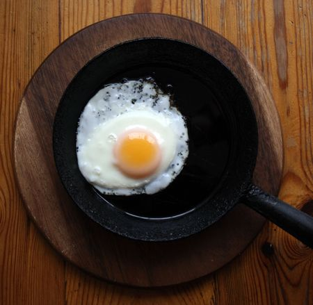 scrambled egg on a black frying pan