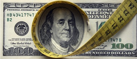 FinanceInvestment ConceptCreative photo about financial crisise. Measuring tape over money