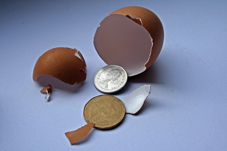 FinanceInvestment ConceptSeveral CANADIAN coins are being hatched from an egg shell. photo