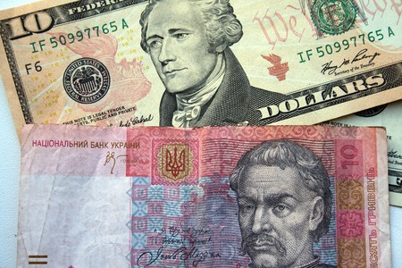 american dollars and ukranian hrivna background photo