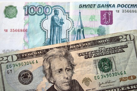 american dollars and russian rouble background photo