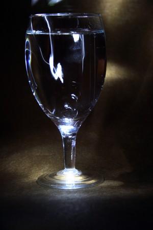darck: Glass of white wine on darck background Stock Photo