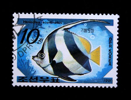 postmail: A stamp printed by DPR KOREA (North Korea) shows a fish Heniochus acuminatus, statp from series