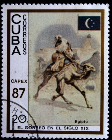 postmail: A stamp printed in Cuba show a stage from a life of post of Egypt, one stamp from series circa 1987 Stock Photo