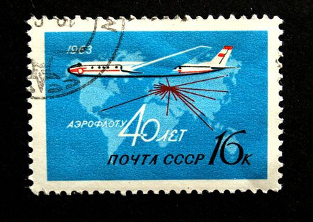 stamp printed in the USSR show vintage soviet pasenger  jet , devoted 40 years anniversary of Aeroflot, circa 1963 photo