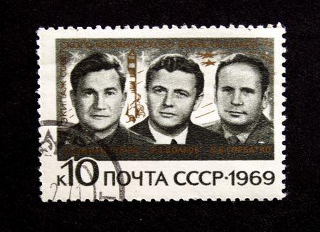 vostok: A stamp printed in the USSR show cosmonauts Cosmonauts Philipchenko, Volkov, Gorbatko, one stamp from series, circa 1969 Stock Photo