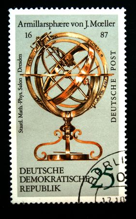 ddr: A stamp printed in the DDR (East Germany) shows vintage astrolabe, one stamp from series devoted State saloon of physics in Dresden, circa 1970s.