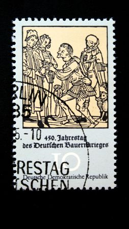 revolt: A stamp printed in DDR (East Germany) devoted 450 anniversary of German farmers revolt show Ancient engraving with a stage of revolt, one stamp from series, circa 1970s