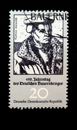 revolt: A stamp printed in DDR (East Germany) devoted 450 anniversary of German farmers revolt show Tomas Muncer, one stamp from series, circa 1970s