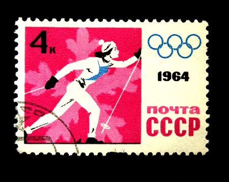 devoted: A stamp printed in the USSR shows skier, devoted Winter Olympic Games, one stamp from series, circa 1964 Editorial