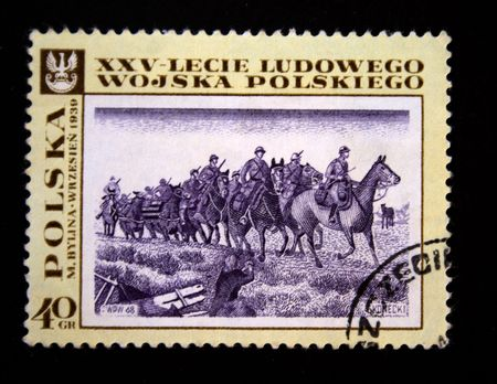 A stamp printed in Poland devoted 25 years of Polish army  shows Group of the armed horsemen in the military form, circa 1968 photo