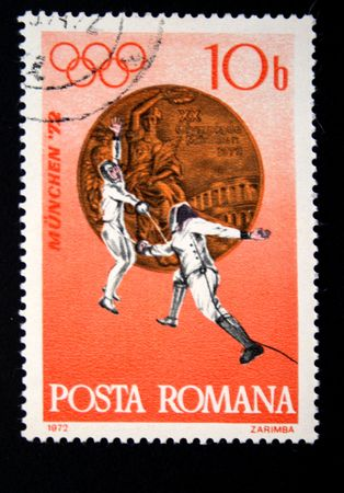 fencers: A stamp printed in Romania shows fencers, one stamp from series devoted Olimpic Games in Munchen, circa 1972 Editorial