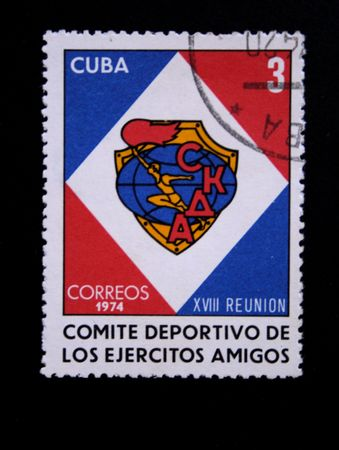 committee: A stamp printed in Cuba shows Emblem of soviet sports committee of the armies friends, circa 1974