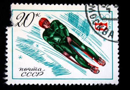 bobsled: A stamp printed in the USSR shows bobsled, devoted to the Winter Olympic Games in Insbruk, one stamp from series, circa 1976.