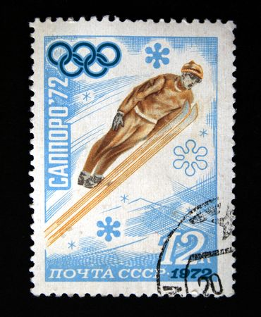 postmail: A stamp printed in the USSR shows ski jumper, devoted Winter Olympic Games in Sapporo, one stamp from series, circa 1972.