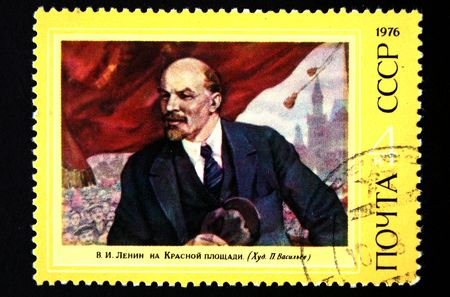 lenin: A stamp printed in USSR shows Lenin on Red square, circa 1976. Stock Photo