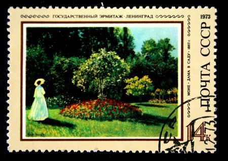 A stamp prunted in the USSR shows paint Woman in a Garden by artist Claude Monet, stamp from collection Hermitage, circa 1973