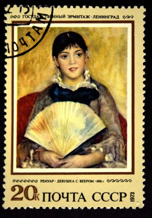 A stamp prunted in the USSR shows paint Girl with a fan by artist Pierre-Auguste Renoir, stamp from collection Hermitage, circa 1973