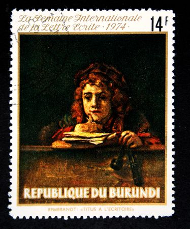 rembrandt: A stamp printed in Burundi shows paint Titus on the lesson by artist Rembrandt, one stamp from series, circa 1974 Stock Photo
