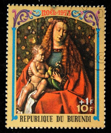 A stamp printed in Burundi shows Christmas scene - Mother of God with child, one stamp from series, circa 1973 photo