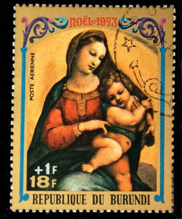 religious icon: A stamp printed in Burundi shows Christmas scene - Mother of God with child, one stamp from series, circa 1973