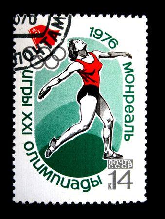 lanzamiento de disco: Un sello imprimido en la URSS muestra Discus throw, dedicado a Juegos Ol�mpicos de Montreal, un sello de serie, alrededor del a�o 1976  Editorial