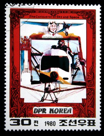 conqueror: A stamp printed in DRK Korea (North Korea) shows Antony Fokker and his plane, one stam from series The Conqueror of Sky and Space, circa 1980 Stock Photo