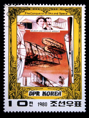 conqueror: A stamp printed in DRK Korea (North Korea) shows Wright brothers and their plane, one stam from series The Conqueror of Sky and Space, circa 1980