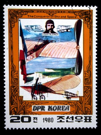 A stamp printed in DRK Korea (North Korea) shows Louis Bleriot and his plane, one stam from series The Conqueror of Sky and Space, circa 1980 photo