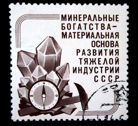 geologists: A stamp printed in the USSR shows geologists instrunets and cristals, circa 1960s