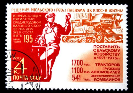 propagation: A stamp printed in the USSR devoted Manufacture of the equipment for an agriculture, from Soviet propagation series, circa 1970.