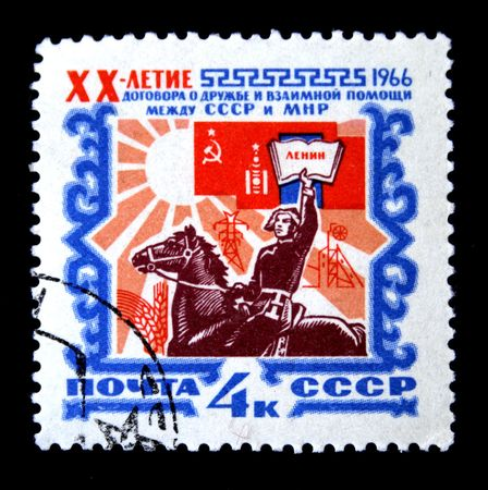 A stamp printed in the USSR honoring 20 years of friendship treaty and cooperation between the USSR and the Mongolian people's Republic, circa 1966