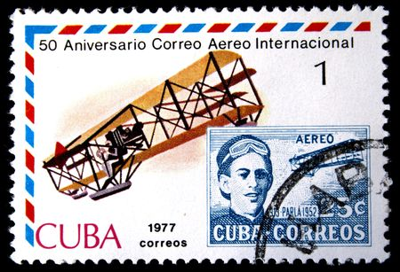 avia: A stamp printed in Cuba shows old post stamp with portrait of pilot and vintage airplane, stamp from series honoring 50 years of Cuban international AVIA post, circa 1977