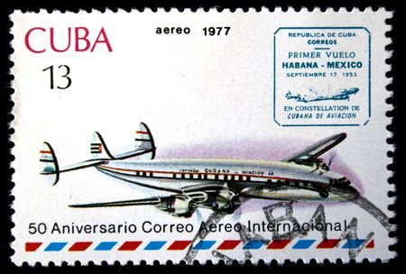 avia: A stamp printed in Cuba shows vintage airplane and devoted first passenger flight from Habana to Mexico, stamp from series honoring 50 years of Cuban international AVIA post, circa 1977 Stock Photo