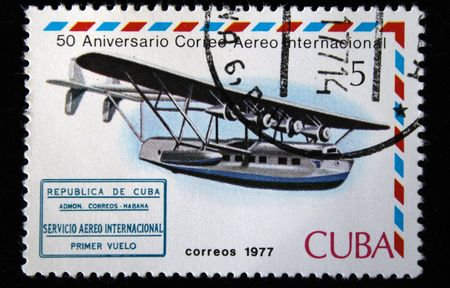 avia: A stamp printed in Cuba shows vintage airplane, stamp from series honoring 50 years of Cuban international AVIA post, circa 1977 Stock Photo