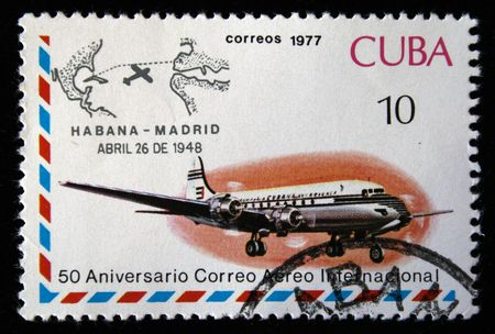 avia: A stamp printed in Cuba shows vintage airplane and devoted first passenger flight from Habana to Madrid, stamp from series honoring 50 years of Cuban international AVIA post, circa 1977