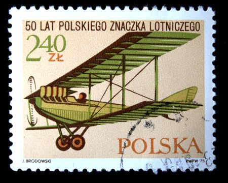 postmail: A stamp printed in Poland shows vintage airplane, devoted 50 years of Polish flight sign, circa 1975