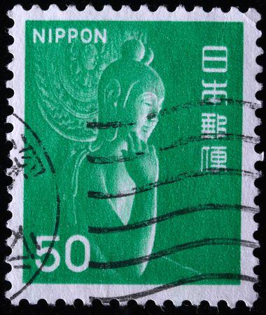 future buddha:  JAPAN - CIRCA 1960s: A stamp printed in Japan shows wooden statue Miroku Bosatsu in Monastery Chuguji, circa 1960s  Stock Photo