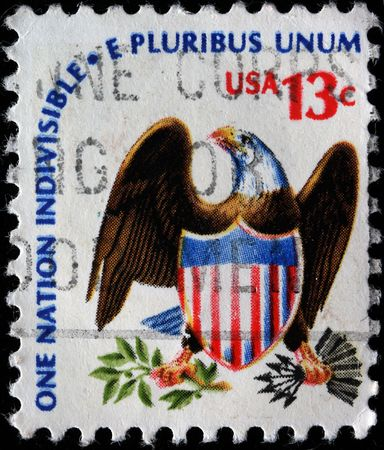 indivisible: UNITED STATES OF AMERICA - CIRCA 1975: A stamp printed in the United States of America shows eagle and shield with the wording