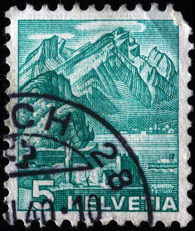 SWITZERLAND - CIRCA 1942: A stamp printed in Switzerland shows Schnitzturm tower in Stansstad , series, circa 1942 Stock Photo - 7419128