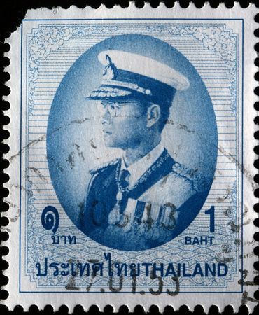 adulyadej:  THAILAND - CIRCA 1997: A stamp printed in Thailand shows Bhumibol Adulyadej Rama IX of Thailand, circa 1997