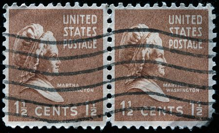 martha:  UNITED STATES OF AMERICA - CIRCA 1938: A stamp printed in the USA shows image of Martha Washington, the wife of George Washington, circa 1938