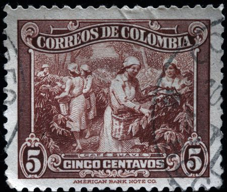 cancelled stamp:  COLOMBIA - CIRCA 1940s: A stamp printed in Colombia shows coffee harvesting, circa 1940s