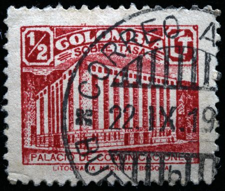 A stamp printed in Colombia shows Palace of Communications photo