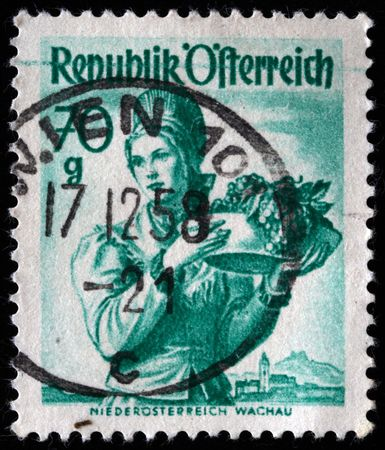 AUSTRIA - CIRCA 1958: A stamp printed in Austria shows woman with fruts, circa 1958  Stock Photo - 7448625